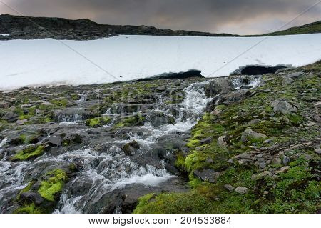 Waterfall in the mountains along the National tourist route Aurlandstjellet. Flotane. Western Norway