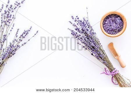 natural cosmetics with lavender and herbs for homemade spa on white table background top view mock up