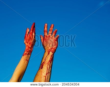 Bloody Zombie Hands With Red Blood On Blue Sky