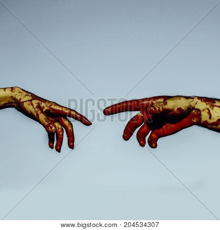 Halloween Hands Reaching Each Other On Blue Sky Background