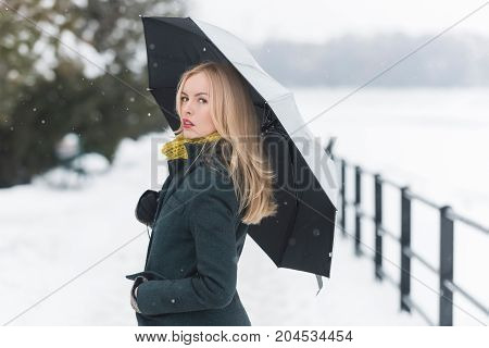 Model In Grey Coat, Scarf And Mittens