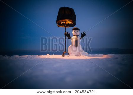 New Year Snowman From Snow In Hat, Gloves And Tie.