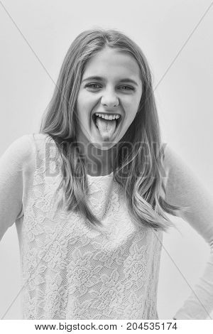 Pretty Happy Young Girl With Blond Hair Showing Tongue
