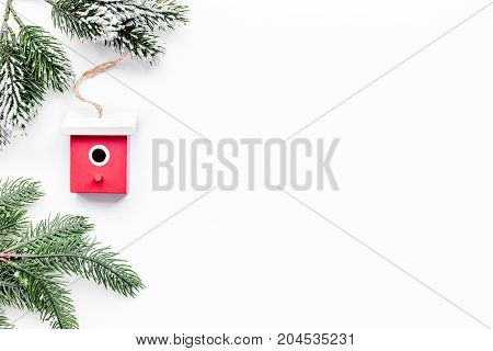 New Year decorations with toys and christmas tree branche on white table background top veiw mock up