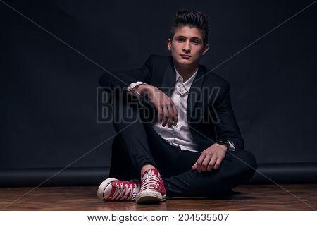 One Young Teenage Boy, Sitting On Floor