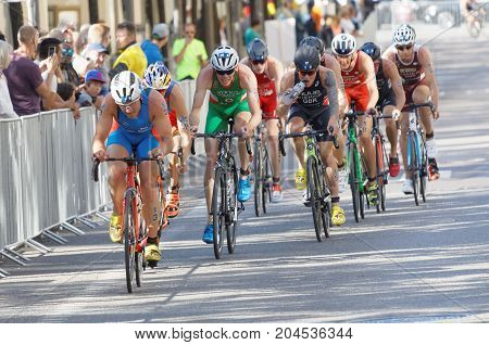 STOCKHOLM - AUG 26 2017: Group of fighting cycling triathletes Blummenfelt Bishop and competitors in the Men's ITU World Triathlon series event August 26 2017 in Stockholm Sweden