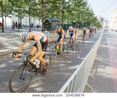 STOCKHOLM - AUG 26 2017: Jonathan Brownlee Justus Nieschlag and group of male triathlete cyclists in the Men's ITU World Triathlon series event August 26 2017 in Stockholm Sweden