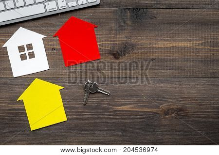 purchasing house set with paper figure on work desk wooden background top view mock up