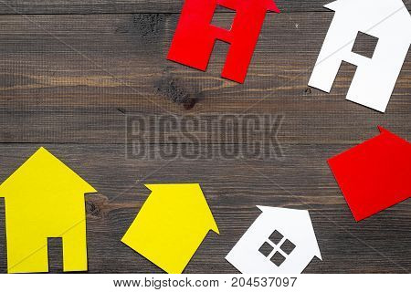 selling property online set with paper house on office desk wooden background top view mockup