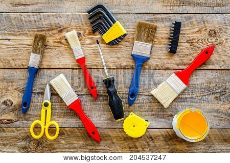 set of tools for build, paint and repair house on wooden desk background top view pattern