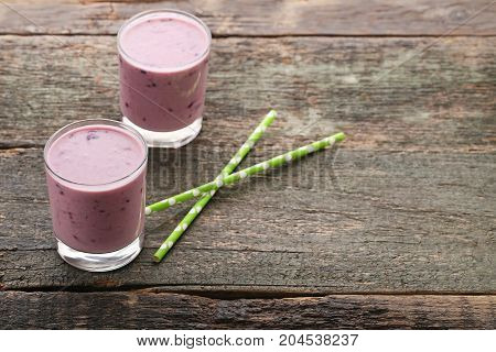 Fresh Blueberry Smoothie In Glasses On Wooden Table