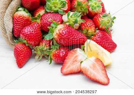 a canvas sack full of red strawberry