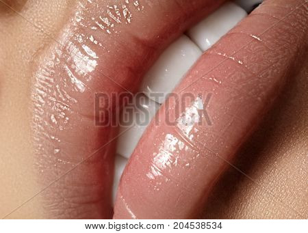 Closeup plump Lips. Lip Care Augmentation Fillers. Macro photo with Face detail. Natural shape with perfect contour. Close-up perfect natural lip makeup beautiful female mouth. Plump sexy full lips poster