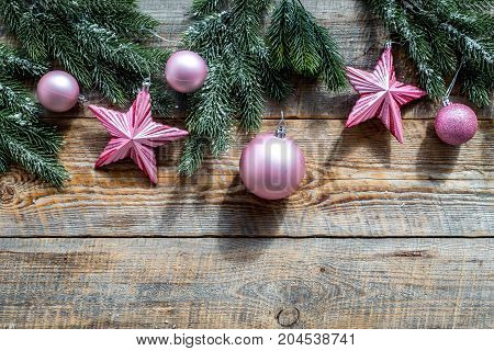 Star and balls for christmas tree on pine branches on wooden background top view.