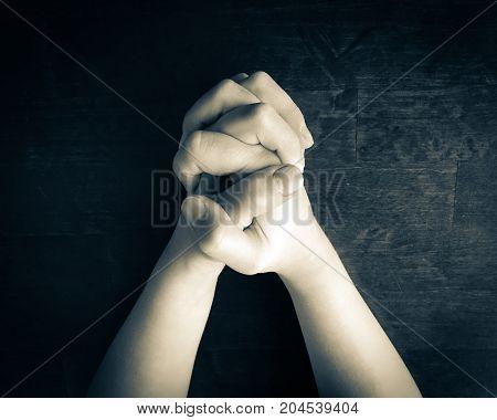 close up photo of praying child hands.