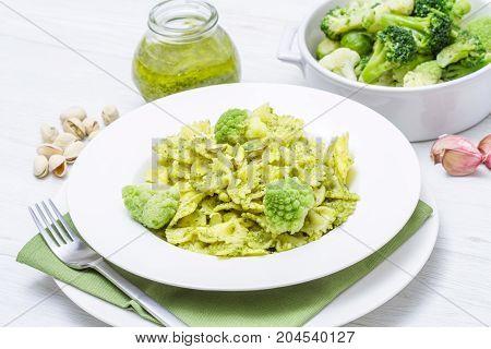 a pasta with broccoli pesto and pistachios
