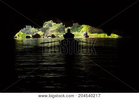 A Boat Inside A Flooded Cave At Trang An Unesco World Heritage Site In Ninh Binh, Vietnam
