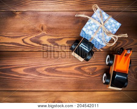 Gift box and toy machinery. Gift delivery service concept. Shallow focus