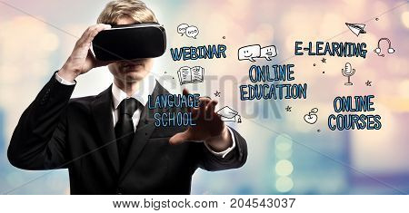Online Education text with businessman using a virtual reality headset