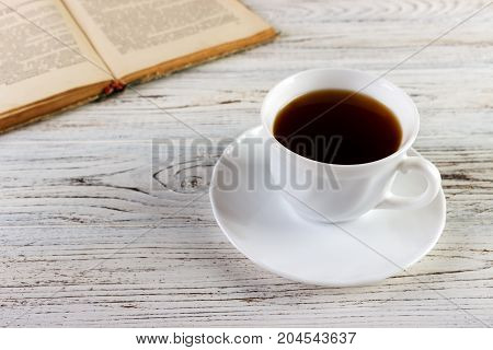 Drink a cup of coffee reading book