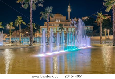 ALBANIA DURRES - September 22 2015: Main Mosque in Durres city - Albania. Evening view the mosque of Fatih with illumination and fountains