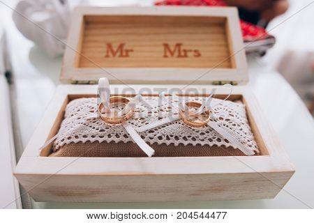 Golden Wedding Rings In A White Wooden Box. Wedding Decoration. Symbol Of Family, Unity And Love