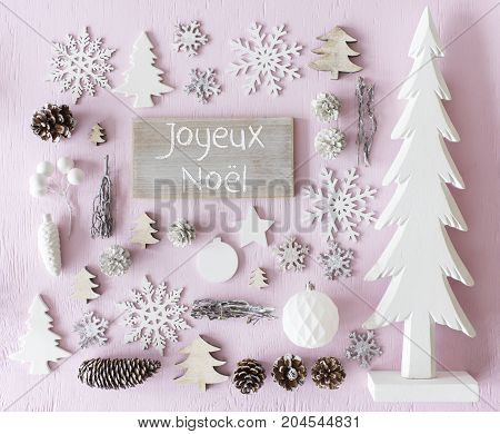 Sign With French Text Joyeux Noel Means Merry Christmas. Flat Lay Of Christmas Decoration Like Tree, Ball, Star And Fir Cone. Rose Quarty Wooden Background
