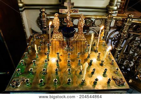 Stand For Candles In The Interior Of Orthodox Church, Golden Candleholder In Church,orthodox Icon La
