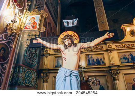 Dnipro Ukraine - August 06 2017: crucifixion of Jesus Christ on the background of the altar in the church or the cathedral symbol of God's lovesymbol of christian religion and belief.