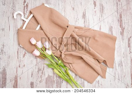 Beige Coat With A Belt, Pink Tulips, White Trempel. Fashionable Concept. View From Above