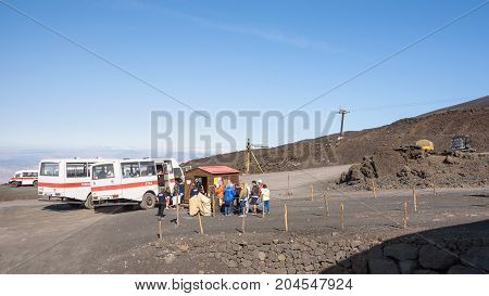 Etna Sicily Italy - August 21 2017: People boar the bus to the top of Mount Etna