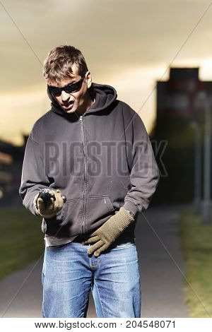Armed man operating on public with pistol