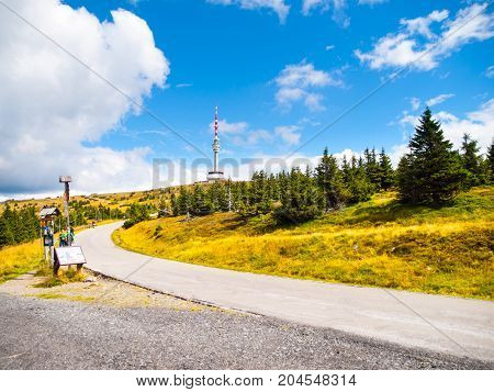 Asphalt road leading to TV transmitter and lookout tower on the summit of Praded Mountain, Hruby Jesenik, Czech Republic.