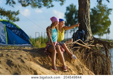 boy and girl with looks into the distance. Adventure, travel, tourism concept.
