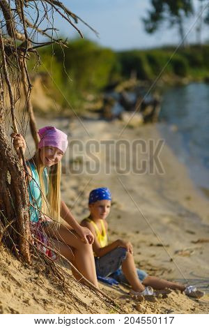 boy and girl go down the sand to the beach. Adventure, travel, tourism concept.