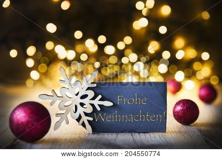 Plate With Golden German Text Frohe Weihnachten Means Merry Christmas. Bright Glowing Lights In The Background. Christmas Ornament Like Red Balls And Snowflake.