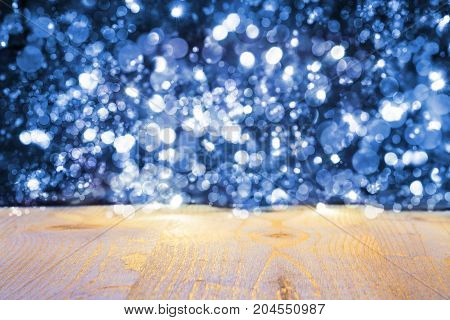 Christmas Background With Blue Bright Glowing Lights. Wooden Background With Copy Space For Advertisement