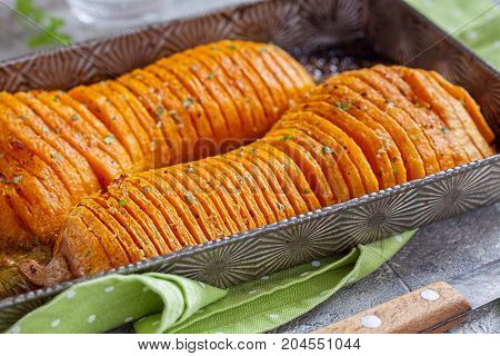 Roasted hasselback butternut squash pumpkin with garlic