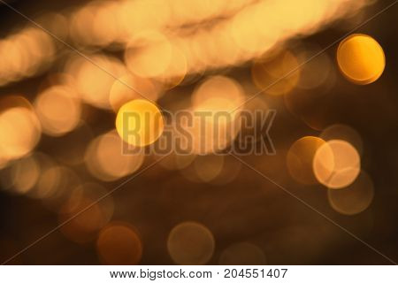 Blurry Lights Texture With Bronze Bokeh Effect. Party, Celebration Or Christmas Background.