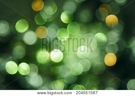 Sparkling Green Lights Texture With Bokeh Effect. Celebration, Party Or Christmas Background.