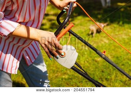 Woman Being Mowing Lawn With Lawnmower