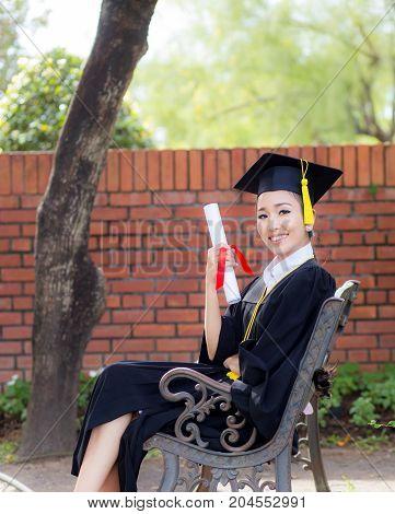 Happy graduated student girl congratulations - graduate education success - concept education.