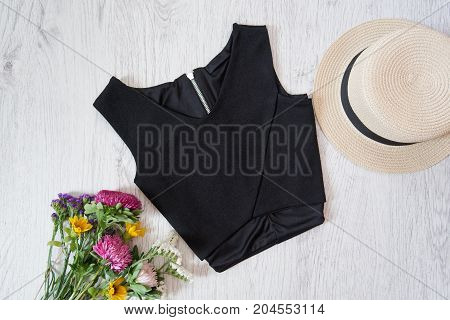 Black Top. Hat And Bouquet Of Wildflowers. Fashionable Concept, Top View