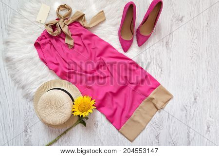 Pink Dress With Tag, Shoes, Hat And Sunflower. Fashionable Conceptpink Dress With Tag, Shoes, Hat An