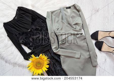 Black And Gray Dress, Sunflower And Black Shoes On White Fur.  Fashionable Concept