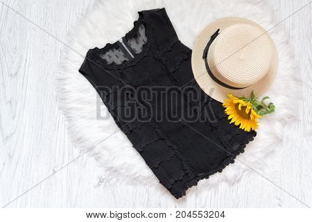 Black Lace Blouse. Hat And Sunflower On White Fur. Fashionable Concept, Top View