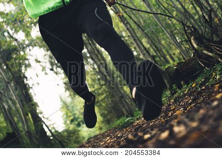 Athlete Is Man Quickly Runs Across Rough Terrain In Forest. Outdoors Fast Running And Training. Inte