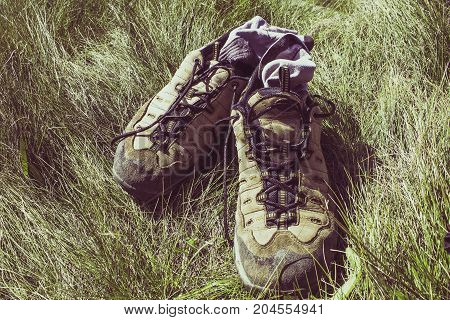 Mountain boots in the grass with socks