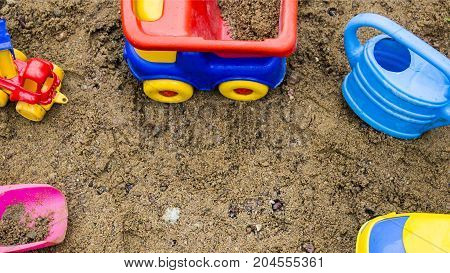 Toys in the sandbox - Watering can dump truck shovel