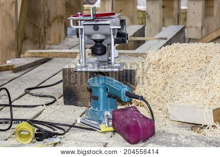 The process of treating wood Carpenter working with grinder